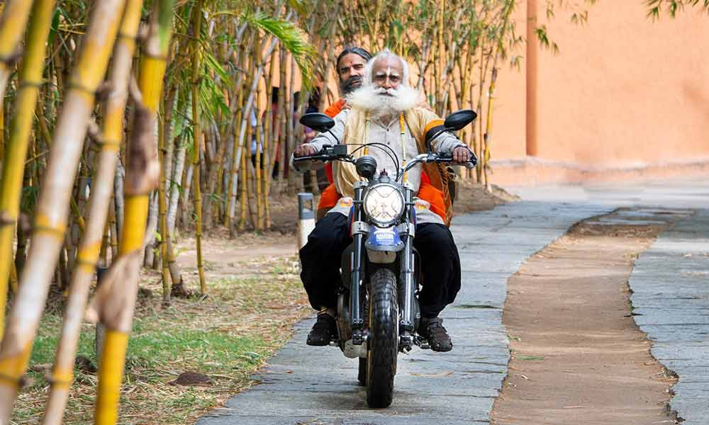 Sadhguru on Bike with Baba Ramdev